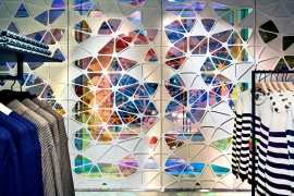 Kaleidoscope-like 'veil' immerses Parisian shoppers into a world of intricate geometries and vivid colours