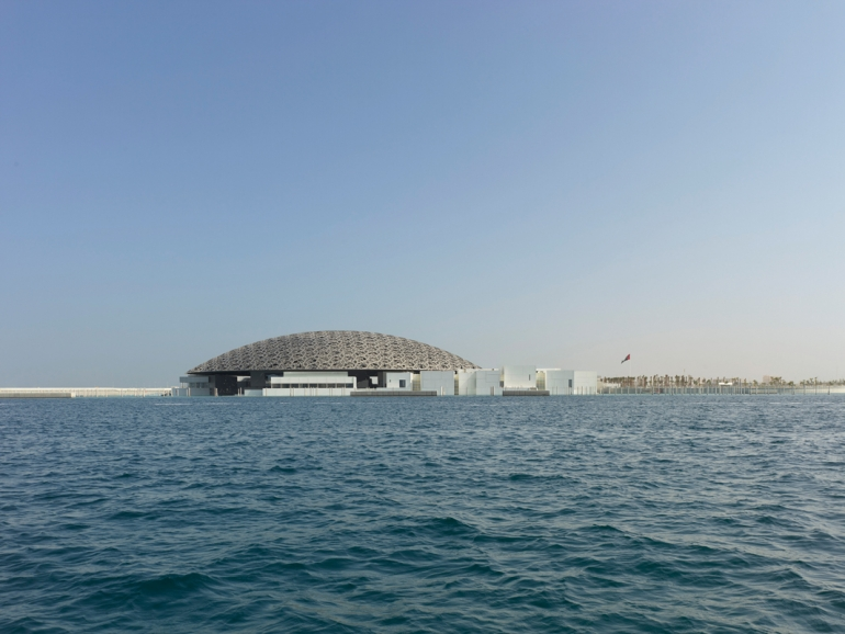 Jean Nouvel's Louvre Abu Dhabi lights up sky on Saadiyat Island